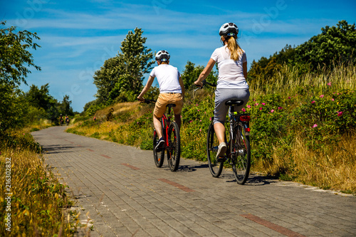 Healthy lifestyle - people riding bicycles  - 216302832