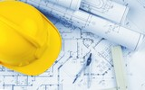 Blueprints and a hardhat - 216306670