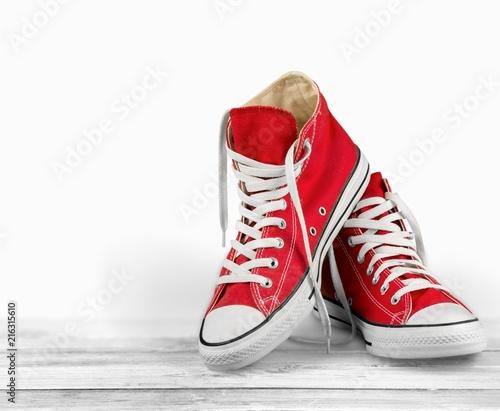 Foto Murales Pair of new red sneakers