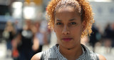 Hispanic woman in city face portrait - 216327892
