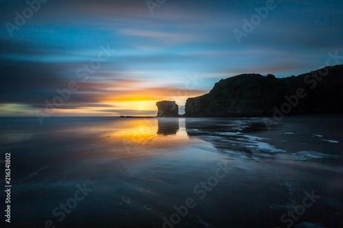 Fotobehang Zee zonsondergang Maori Bay NZ