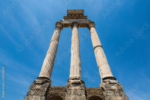 Looking up at column ruins in the Roman forum in Rome, Italy