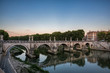 Pont St Angelo reflected in the Tiber river in Rome, Italy