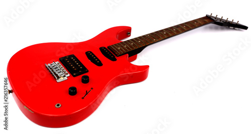 Red electric guitar with white backdrop. - 216357646