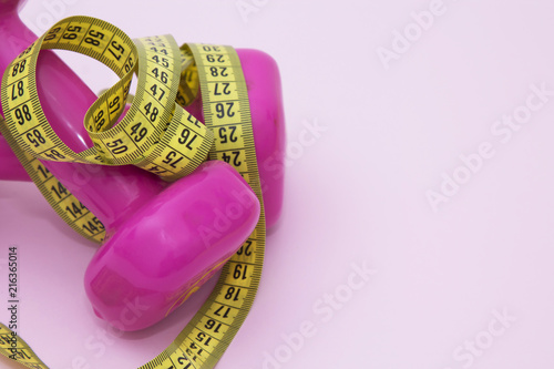 Sticker dumbbells and tape measure, concept of diet and exercise