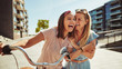Leinwanddruck Bild - Laughing female friends having fun walking together through the
