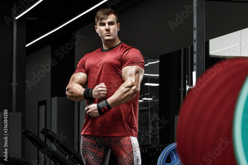 Sticker Muscular man working out in gym, strong bodybuilder male