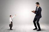 Small businessman in shirt pointing to an afraid businessman  - 216392661