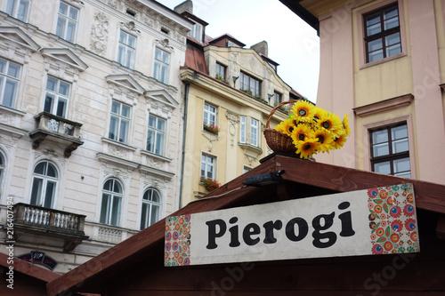 Foto Spatwand Krakau Pierogi sign in Krakow market