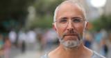 Mature caucasian man in city face portrait - 216422632