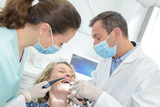 Woman giggling in dentist's chair
