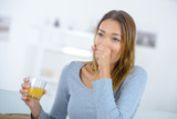 woman coughing drinking juice