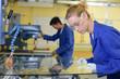 Leinwandbild Motiv worker inspecting a glass