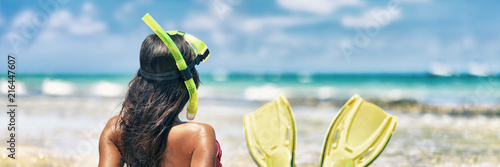 Leinwanddruck Bild Snorkel girl with scuba mask and snorkeling fins relaxing on Caribbean beach travel summer vacation panoramic banner. Ocean watersport tropical fun.