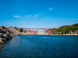 Red Maslenica bridge crossing the Adriatic sea in Zadar county, Croatia.