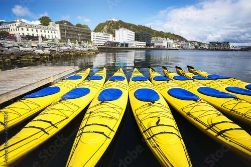 Leinwanddruck Bild a group of kayaks in alesund