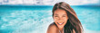 Leinwandbild Motiv Beautiful Asian woman smiling relaxing on summer beach sunbathing banner panorama.