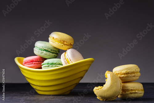 Plexiglas Macarons Macarons piled in a yellow dish.