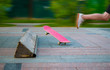 Feet of skateboarder perform stunts in city Park, street youth sports, healthy life concept