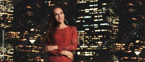Leinwandbild Motiv Beautiful lady in a night city