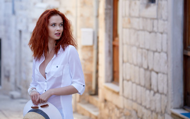 Woman traveller enjoys scenic view of coast in Dalmatia, Croatia.