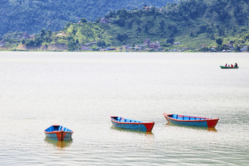 Small wooden boats on the Phewa Lake in Pokhara, Nepal