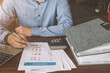 Leinwandbild Motiv Businessman  or accountant using calculator to calculate budget planner, Business financial concept.