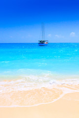 Sailing yacht in turquoise ocean near the beach