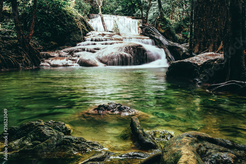 beautiful waterfall in green forest - 216523049