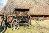 A wooden cart, a cart under a horse harness.
