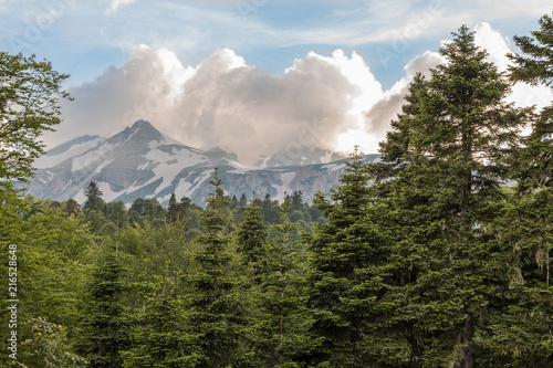 Foto Spatwand Zomer Tops of the Caucasus Mountains in clouds