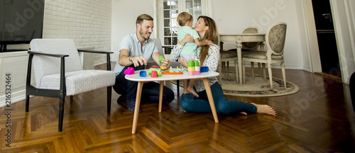 Foto Murales Happy family playing in the living room