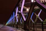 Illuminated colorful bridge at night, Bratislava
