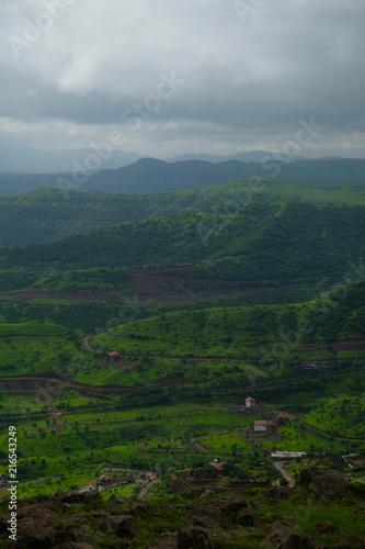 Fotobehang Donkergrijs Lush green monsoon nature landscape mountains, hills, Purandar, Pune, Maharashtra, India