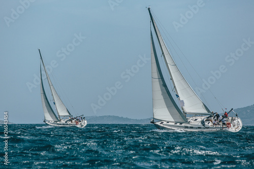 Canvas Zeilen Two yachts sail boats racing in a blue sea
