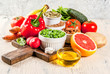 Healthy food background, trendy Alkaline diet products - fruits, vegetables, cereals, nuts. oils, light concrete background