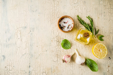 Fresh herbs and spices and lemon for cooking. above copy space, preparation food background