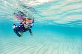 Little girl snorkeling - 216551015