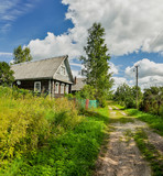 Old wooden log houses in the countryside.