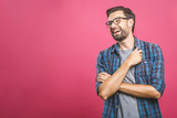 Portrait of a handsome casual man who laughs, standing and laughing over pink background - 216575284