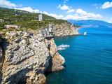 Scenic rocky coastline with castle Swallow's Nest in Crimea - 216578217