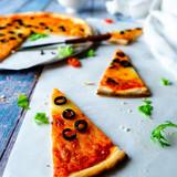Sliced Pizza on Blue Background