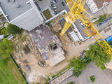 yellow tower crane for construction of new high-rise apartment building. aerial top view