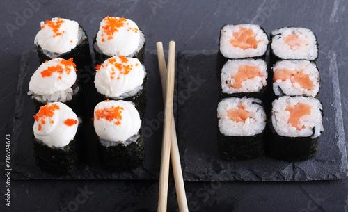 Foto Spatwand Sushi bar Maki rolls with over grey background. Japanese Sushi. close up.