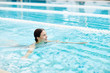 Quadro Happy and pretty woman swimming in pool at leisure or having spa procedure at resort