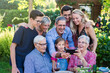 During a bbq, the family have fun sharing a video on a phone - 216623048