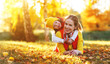 Leinwanddruck Bild - happy family mother and child daughter on   autumn walk
