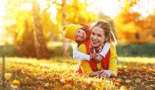 Leinwanddruck Bild happy family mother and child daughter on   autumn walk