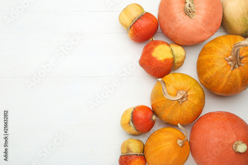 Foto Murales Orange pumpkins on white wooden table