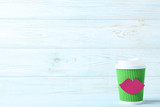 Cup of coffee with paper lips on wooden table - 216634073